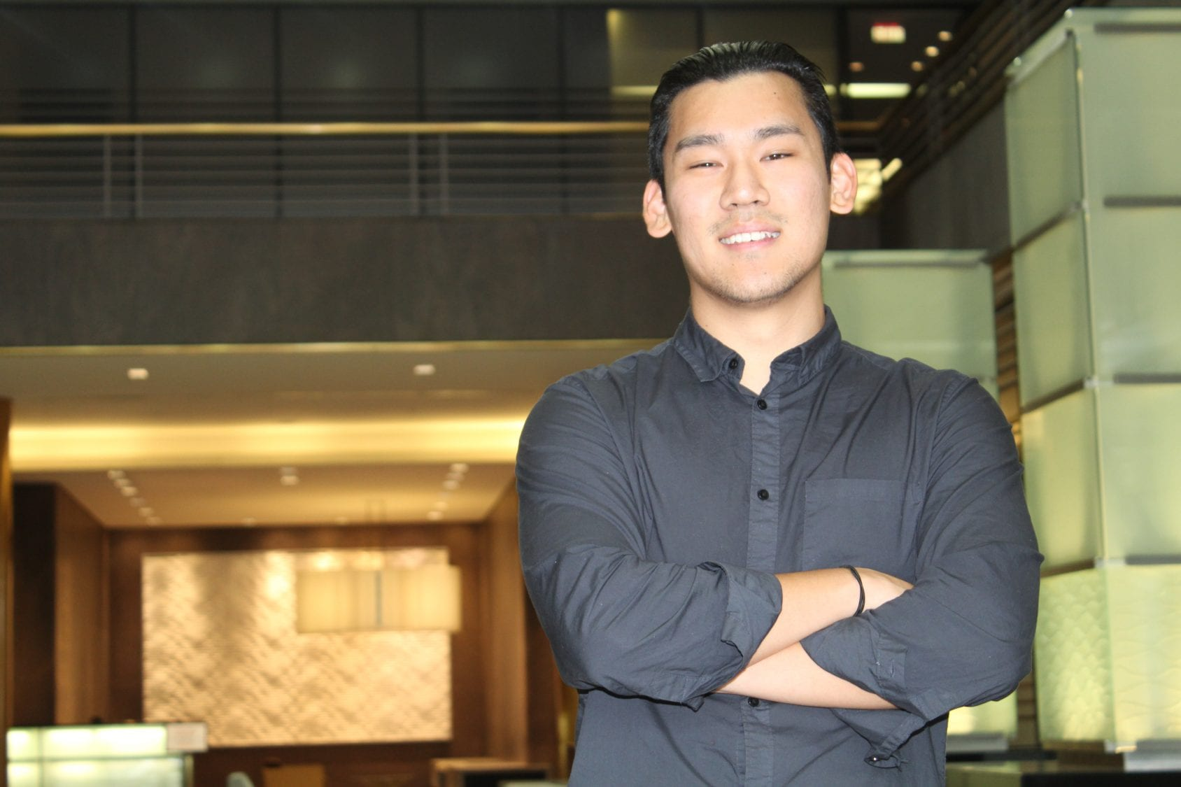 Student entrepreneur standing in lobby and outside of office building