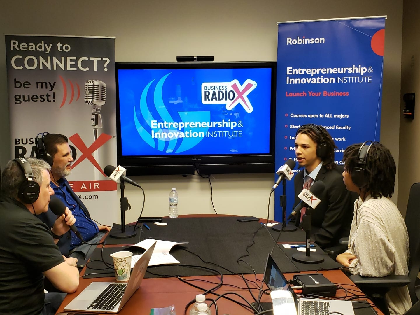 Business RadioX at GSU interviews on site.